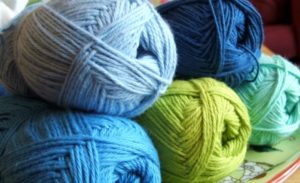 yarn skeins in blues and greens