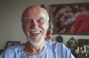 Ram Dass beaming