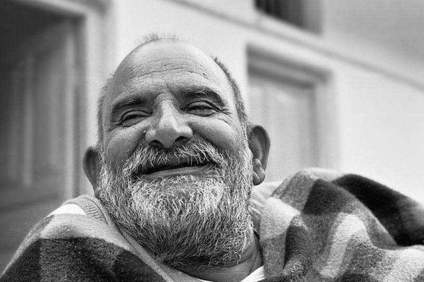 Laughing Neem Karoli Baba in black and white