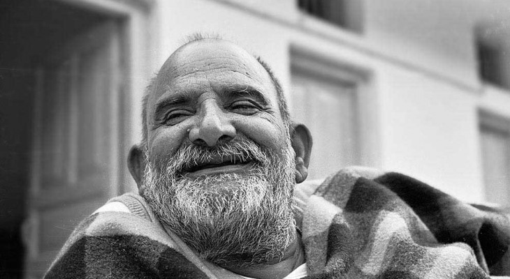 Laughing Neem Karoli Baba in black and white