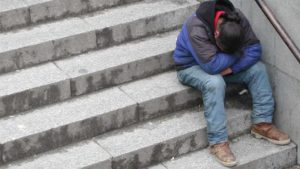Seeking human kindness (homeless sign)